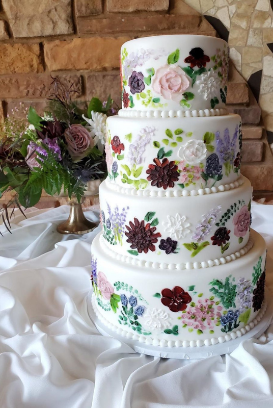 4-tier Hand-painted floral detail wedding cake