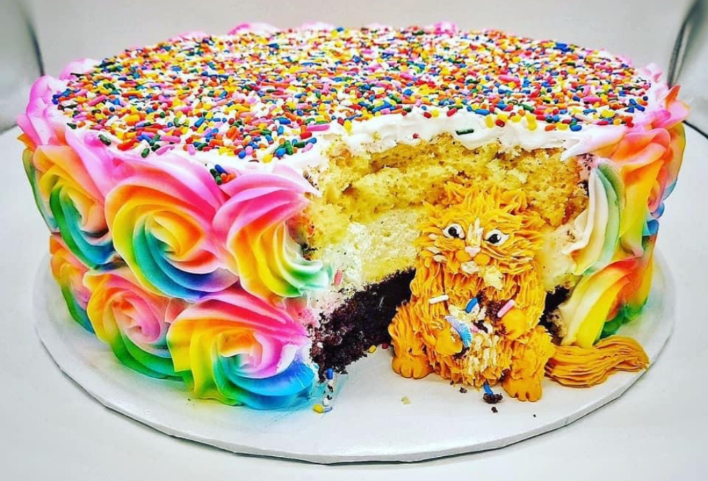 Cat eating chunk out of cake birthday design